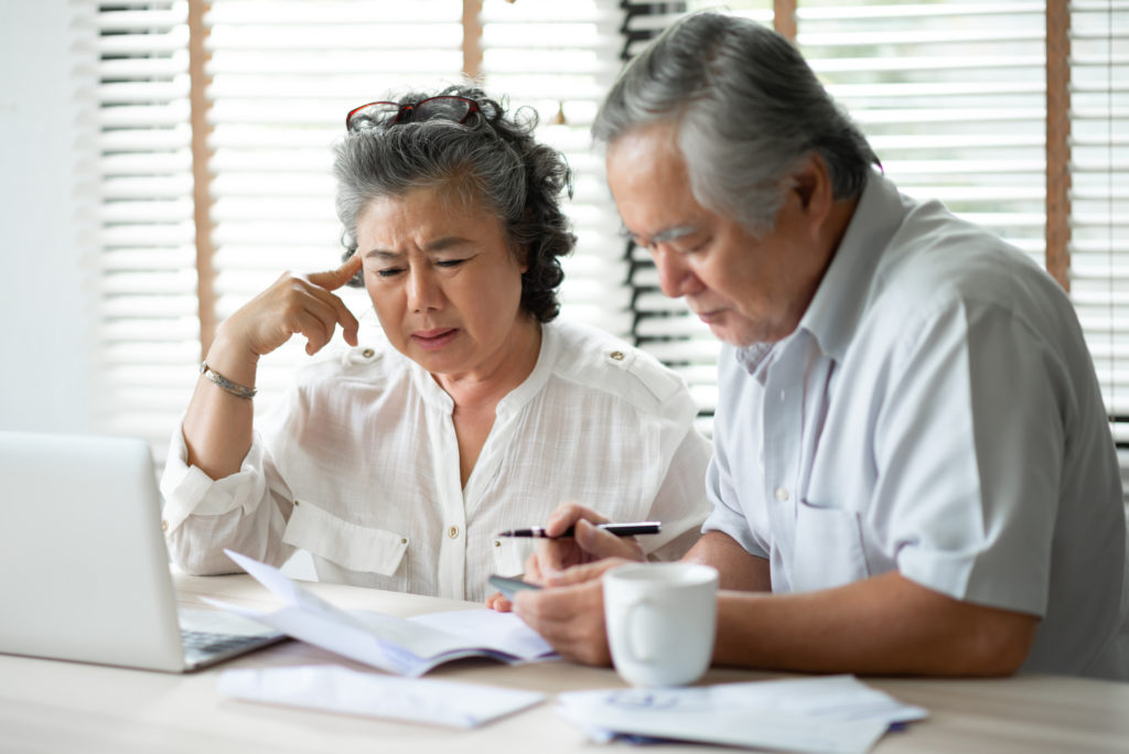 Serious Asian Senior Couple thinking about their Debts with laptop computer. Saving, Financials, monthly expense with Retirement.
